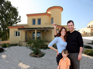Family with newly purchased spanish house